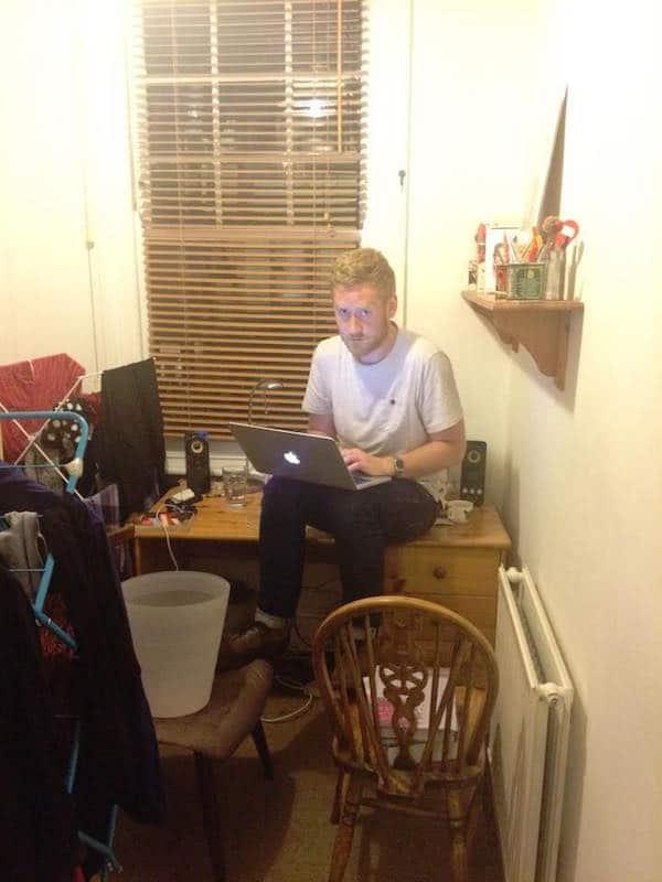 A man sitting on a desk.