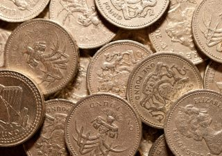 Macro study of a bunch of £1 pound coins