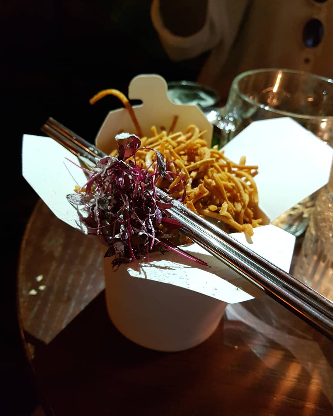 Yes, this is a COCKTAIL. It's made with Jack Daniels, matcha plum wine, cardamom-ginger brew and yuzu juice, and topped with crunchy noodles. ( by @rosiexrozx)