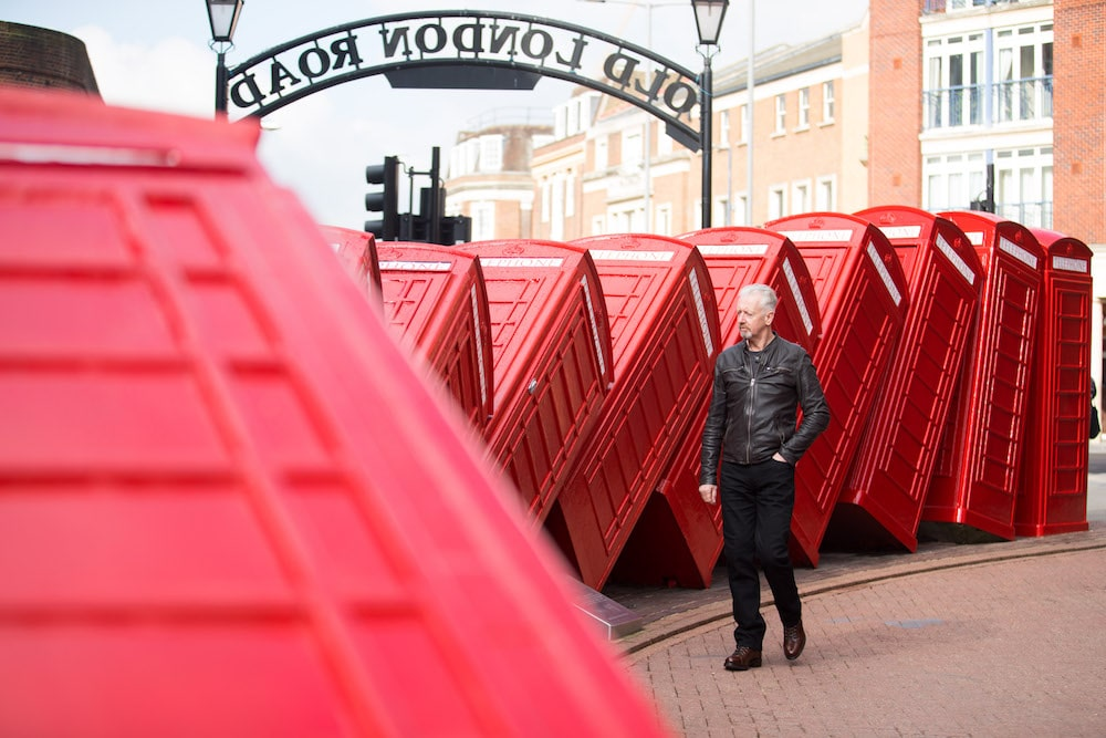 David Mach beside his Kingston sculpture, 'Out of Order.'