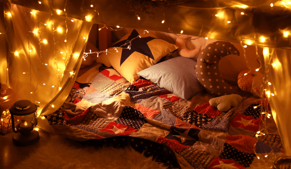 pillow fort makes for an excellent budget-friently staycation ideas