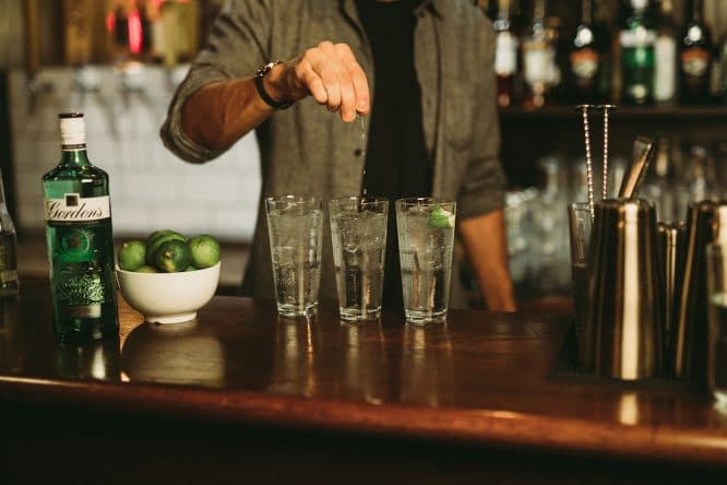 Bartender mixes Gordon's and tonic at Fulham Market Halls